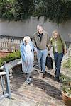 Mature couple walking with senior woman towards front of house Stock Photo - Premium Royalty-Free, Artist: Masterfile, Code: 638-01332130