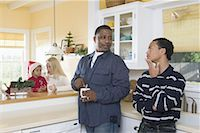 An inter-racial family in the kitchen Stock Photo - Premium Royalty-Freenull, Code: 638-01332215