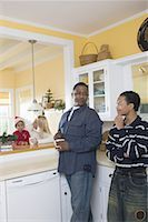 An inter-racial family in the kitchen Stock Photo - Premium Royalty-Freenull, Code: 638-01333278