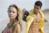 sandi model - Young man photographing woman in swimsuit Stock Photo - Premium Royalty-Freenull, Code: 638-01333405