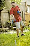 Man tossing horseshoes in backyard Stock Photo - Premium Royalty-Free, Artist: George Shelley, Code: 638-01333801