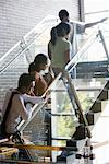 Four students climbing stairs Stock Photo - Premium Royalty-Free, Artist: Masterfile, Code: 638-01334428