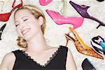 Woman Lying on Floor, Surrounded by Shoes    Stock Photo - Premium Rights-Managed, Artist: Leanne Pedersen, Code: 700-01344563