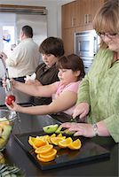 Family Making Fruit Salad    Stock Photo - Premium Rights-Managednull, Code: 700-01345020