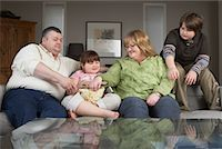 Family on Sofa with Popcorn    Stock Photo - Premium Rights-Managednull, Code: 700-01345024