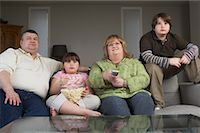 Family Watching Television with Popcorn    Stock Photo - Premium Rights-Managednull, Code: 700-01345025