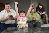 Family Playing Video Game with Popcorn    Stock Photo - Premium Rights-Managednull, Code: 700-01345027