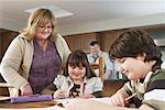 Mother Helping Children with Homework    Stock Photo - Premium Rights-Managed, Artist: Masterfile, Code: 700-01345034