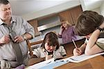 Father Watching Children do Homework    Stock Photo - Premium Rights-Managed, Artist: Masterfile, Code: 700-01345035