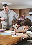 Father Watching Children do Homework    Stock Photo - Premium Rights-Managed, Artist: Masterfile, Code: 700-01345037