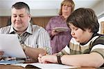 Parents Helping Son with Homework    Stock Photo - Premium Rights-Managed, Artist: Masterfile, Code: 700-01345047