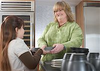 Girl Helping Mother with Dishes    Stock Photo - Premium Rights-Managednull, Code: 700-01345052