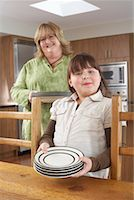 Mother and Daughter Setting Table    Stock Photo - Premium Rights-Managednull, Code: 700-01345053