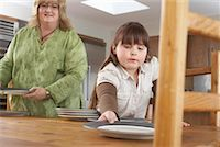 Mother and Daughter Setting Table    Stock Photo - Premium Rights-Managednull, Code: 700-01345054