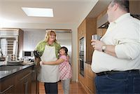 Parents in Kitchen with Daughter    Stock Photo - Premium Rights-Managednull, Code: 700-01345075