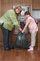 Mother and Daughter with Garbage Bag in Kitchen    Stock Photo - Premium Rights-Managednull, Code: 700-01345079