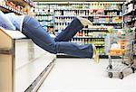 Woman in Grocery Store Climbing Into Freezer    Stock Photo - Premium Rights-Managed, Artist: Noel Hendrickson, Code: 700-01345662