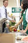 Man at Check-out Counter in Grocery Store    Stock Photo - Premium Rights-Managed, Artist: Noel Hendrickson, Code: 700-01345690