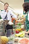 Man at Check-out Counter in Grocery Store    Stock Photo - Premium Rights-Managed, Artist: Noel Hendrickson, Code: 700-01345693