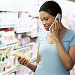 Woman in Grocery Store    Stock Photo - Premium Rights-Managed, Artist: Noel Hendrickson, Code: 700-01345713