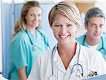 Three hospital workers smiling Stock Photo - Premium Royalty-Freenull, Code: 635-01346808
