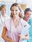 Three hospital workers smiling Stock Photo - Premium Royalty-Freenull, Code: 635-01346866