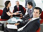 Group of office workers in a meeting Stock Photo - Premium Royalty-Free, Artist: Asia Images, Code: 635-01346950