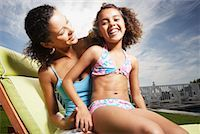 preteen swimsuit - Woman and girl in swimsuit playing outdoors Stock Photo - Premium Royalty-Freenull, Code: 6