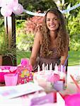 Teenage girl at birthday party smiling outdoors Stock Photo - Premium Royalty-Free, Artist: Masterfile, Code: 635-01347316