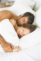 Woman and man lying down in bed Stock Photo - Premium Royalty-Freenull, Code: 635-01347633