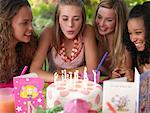 Four teenage girls at birthday party smiling outdoors Stock Photo - Premium Royalty-Free, Artist: ableimages, Code: 635-01347665