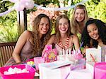 Four teenage girls at birthday party smiling outdoors Stock Photo - Premium Royalty-Free, Artist: Masterfile, Code: 635-01348055