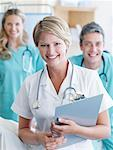 Three hospital workers smiling Stock Photo - Premium Royalty-Freenull, Code: 635-01348207