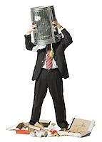 Businessman with trash can on head Stock Photo - Premium Royalty-Freenull, Code: 640-01348387