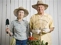 Portrait of an elderly couple standing with gardening tools Stock Photo - Premium Royalty-Freenull, Code: 640-01348436