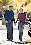 Couple walking in a park Stock Photo - Premium Royalty-Free, Artist: Andrew Olney, Code: 640-01348523