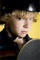 Portrait of a boy with a skateboard Stock Photo - Premium Royalty-Freenull, Code: 640-01348574