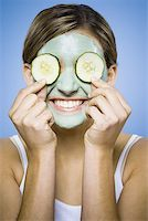 Woman with mud mask and cucumber slices smiling Stock Photo - Premium Royalty-Freenull, Code: 640-01348664