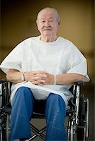 Male patient sitting in a wheelchair with his hands clasped Stock Photo - Premium Royalty-Freenull, Code: 640-01348899