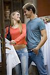 Teenage couple choosing a dress in a clothing store Stock Photo - Premium Royalty-Free, Artist: Transtock, Code: 640-01349016