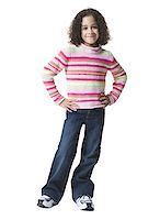 preteen  smile  one  alone - Portrait of a girl smiling and standing Stock Photo - Premium Royalty-Freenull, Code: 640-01349096