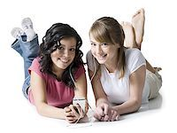 Portrait of two girls listening to music on an MP3 player Stock Photo - Premium Royalty-Freenull, Code: 640-01349312