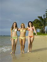 Portrait of three teenage girls walking on the beach Stock Photo - Premium Royalty-Freenull, Code: 640-01349351