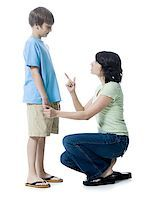 preteen thong - Close-up of a mid adult woman scolding her son Stock Photo - Premium Royalty-Freenull, Code: 640-01349405