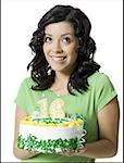 Close-up of a teenage girl holding a birthday cake Stock Photo - Premium Royalty-Free, Artist: F1Online, Code: 640-01349529