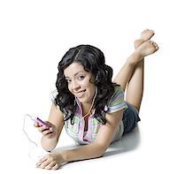 Portrait of a teenage girl listening to an Mp3 player Stock Photo - Premium Royalty-Freenull, Code: 640-01349856