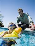Father and son at swimming pool Stock Photo - Premium Royalty-Free, Artist: Kevin Dodge, Code: 640-01349932