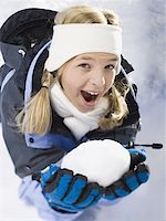 Portrait of a girl holding a snowball Stock Photo - Premium Royalty-Freenull, Code: 640-01350198