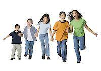 Group of children holding hands and running Stock Photo - Premium Royalty-Freenull, Code: 640-01350411