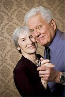 Portrait of an elderly couple dancing Stock Photo - Premium Royalty-Freenull, Code: 640-01350803